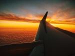 flight-sunset-red-clouds